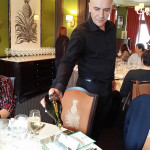 1. waiter pouring wine